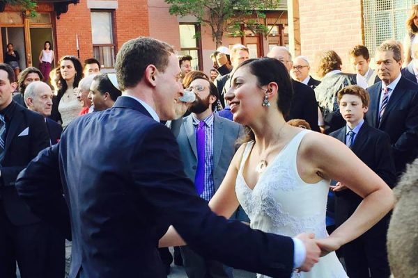 Mark-and-Alizah-outdoors-dancing-outside-the-synagogue
